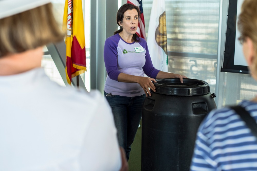 TreePeople's Director of Sustainable Solutions, Lisa Cahill explains how to use a rain barrel in their backyards.