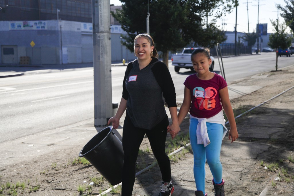 Kristina Nañez and daughter Ryann Riddle care for trees with TreePeople