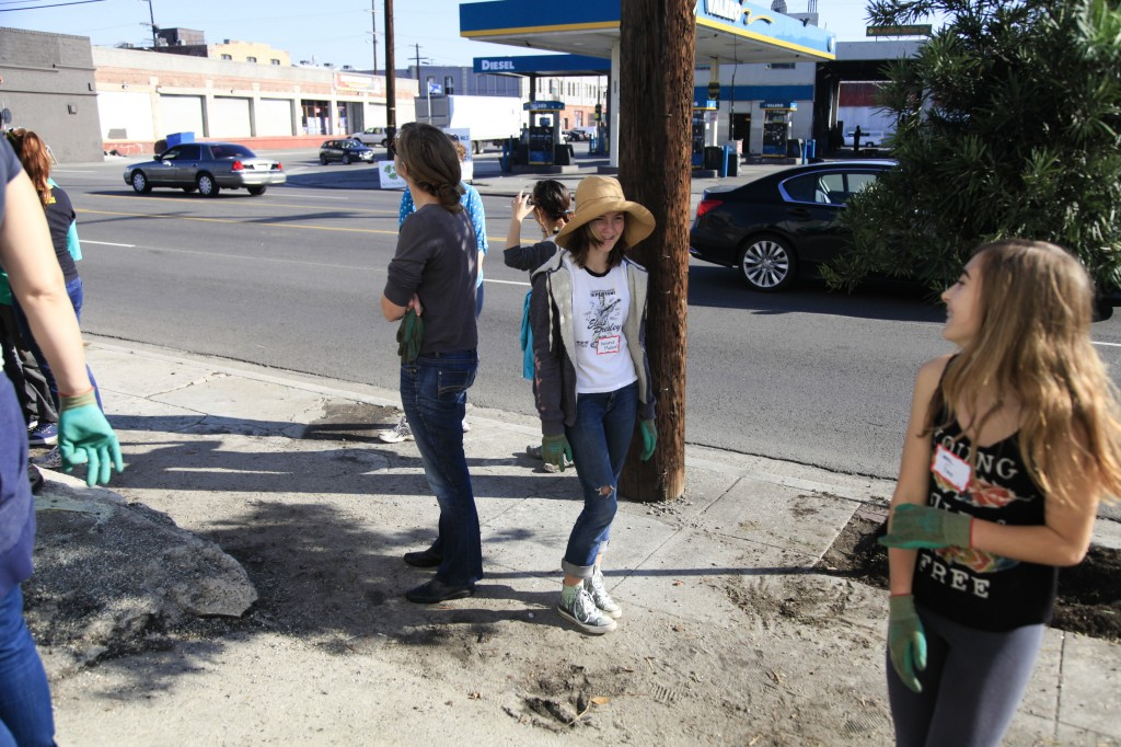 Young girls playing at tree care event on Alameda Street in LA's Downtown