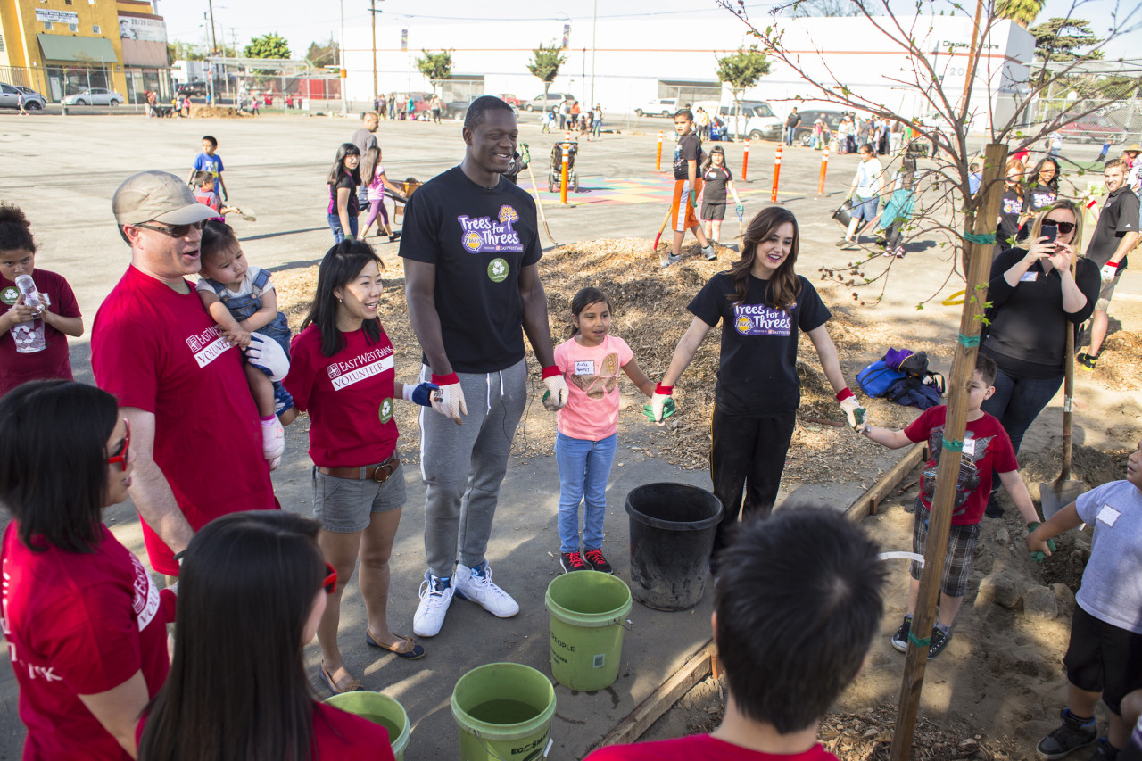 Lakers player Julius Randle joins volunteers from East West Bank in a tree planting ceremony.