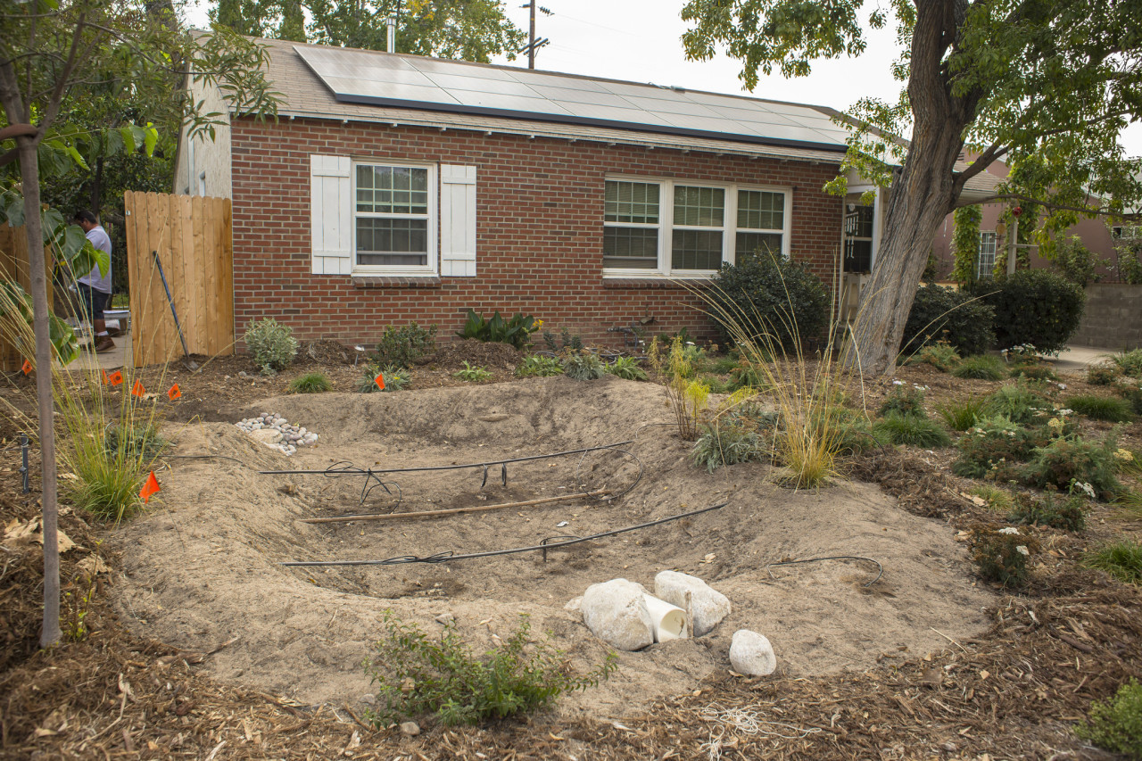 A bioswale (in construction) allows water to replenish our groundwater stores.