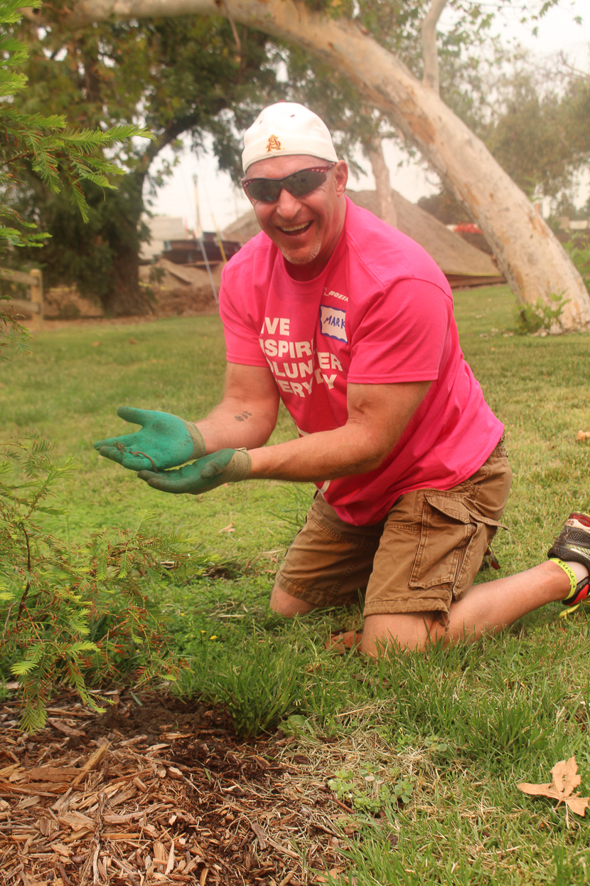 Mark Spiwak, Boeing executive champion and TreePeople Board Member, takes a break from planting trees in Griffith Park to show off an inchworm.